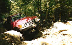 Hal Hall walks his live axle 4-Runner up the rocks on Trail 5